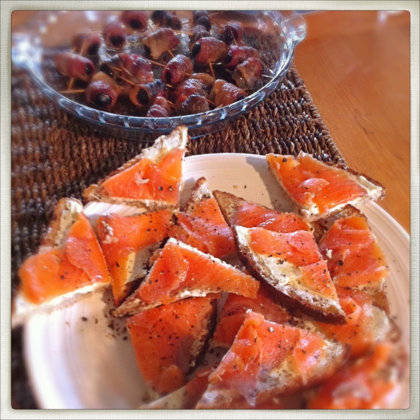 A simple but special snack of cream cheese and smoked salmon on brown bread with lemon and cracked pepper